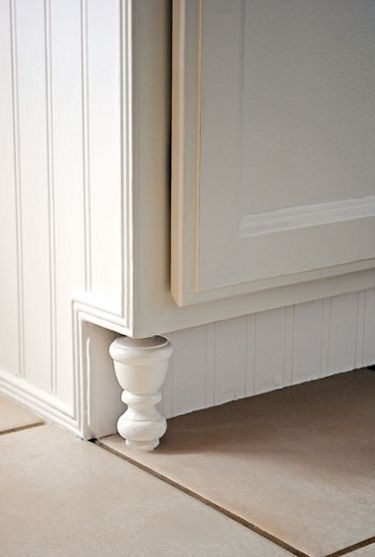 Great idea - finials as feet for kitchen cabinets