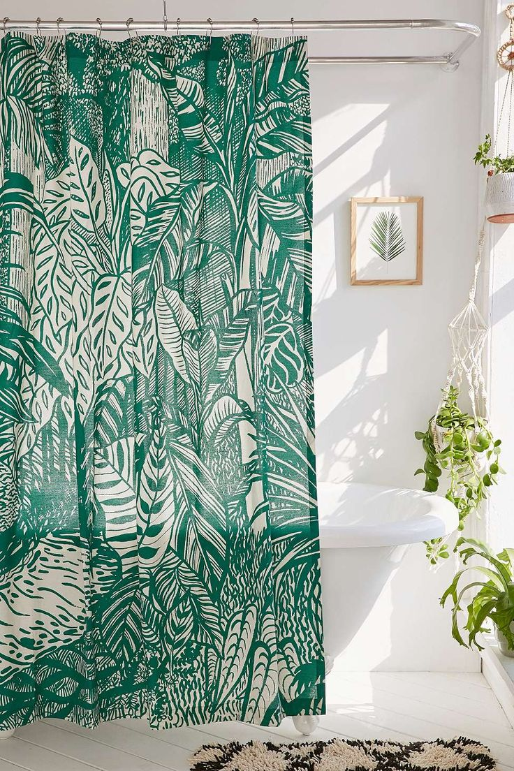 Saskia Pomeroy Plants Shower Curtain | All white bathroom with botanical shower curtain and plants