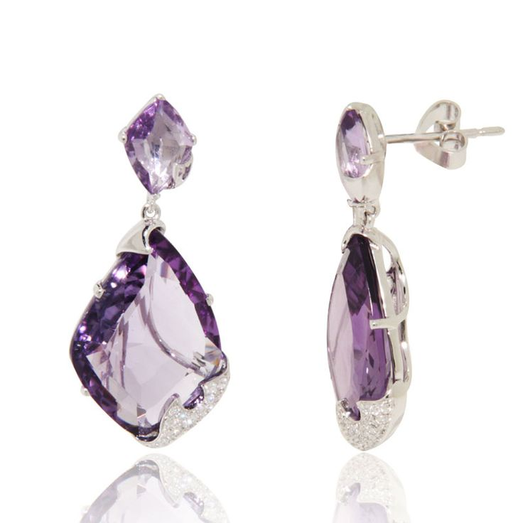 Dangling fancy cut Amethysts (14.49 ct) set creatively in 18k white gold and Diamonds (0.24 ct).