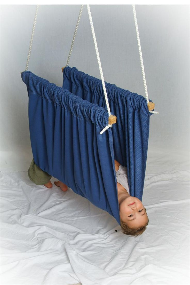 """""""The Soft Taco Swing - Helps to promote the vestibular system by providing uniform pressure around the entire body. The pressure will actually help calm an over-stimulated child, help with self-regulation or help keep the child in a neutral state."""" - As an autistic adult, THAT LOOKS LIKE IT WOULD BE SOOOOOO NICE!"""
