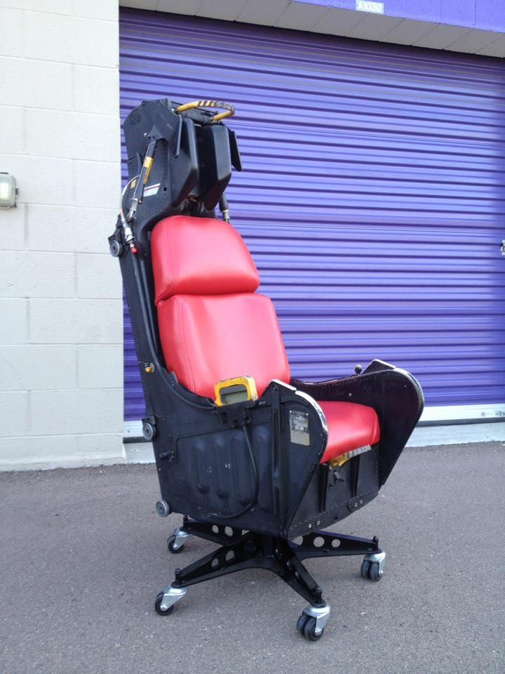 Ejection seat office chair.  It came from an A-7. It was repainted, the seat cushion crafted and covered, and the base created from scratch using a jet cutter and welding torch. Best of all....it reclines slightly to make it more comfortable!