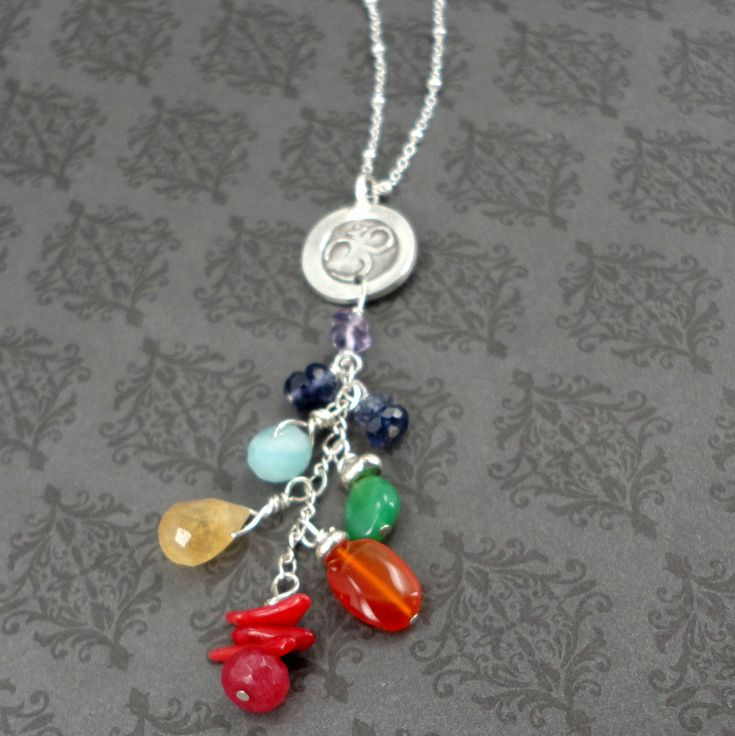 Amethyst is the crowning stone of theOm Chakra necklace- protection, Divine connection. OM CHAKRA NECKLACE Unique design with specially selected gemstones to correspond with each chakra.