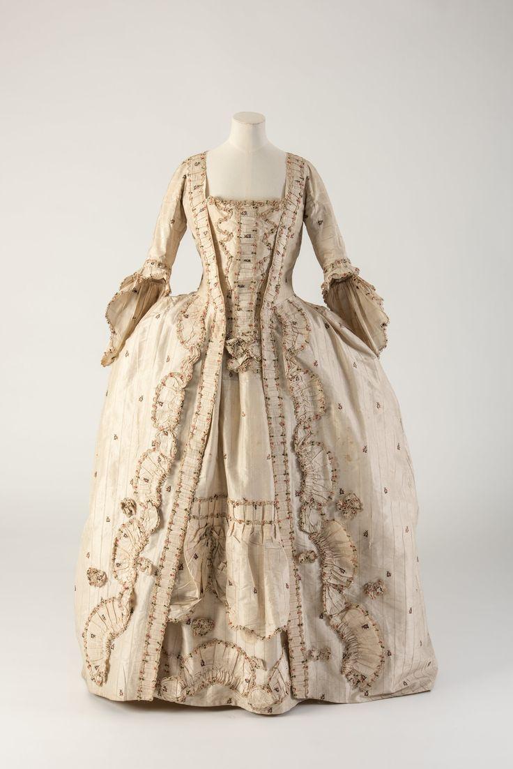 OBJECT 18 - Cream striped and figured woven silk robe à la française , 1770s.  Fashion Museum Bath