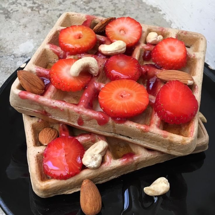 Oatmeal cinnamon waffles with nuts, raspberry jam and fresh strawberries