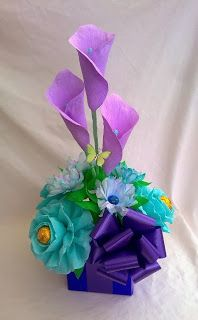 Crepe paper flowers with chocolates gift boxes