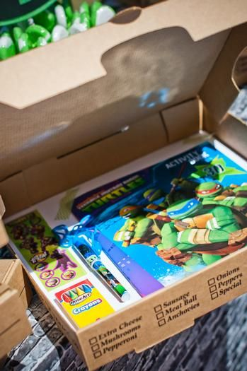 Put the birthday girl or boy's presents in a pizza box to add some TMNT fun to your party