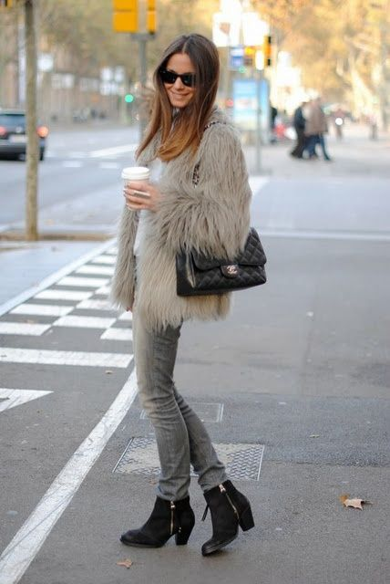 To create an outfit for lunch with friends at the weekend pair a grey fur coat with grey skinny jeans. This outfit is complemented perfectly with black suede booties.  Shop this look for $110:  http://lookastic.com/women/looks/sunglasses-ankle-boots-skinny-jeans-crossbody-bag-fur-coat/5429  — Black Sunglasses  — Black Suede Ankle Boots  — Grey Skinny Jeans  — Black Quilted Leather Crossbody Bag  — Grey Fur Coat