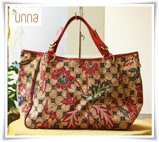 Description:This beautiful batik bag made of Handwritten Batik 3 Negeri combined with genuine red doff lamb leather. Long strap is available in off white. Micro suede lining with 3 pockets inside. Zipper closure    Dimension: 50/40 x 14 x 30