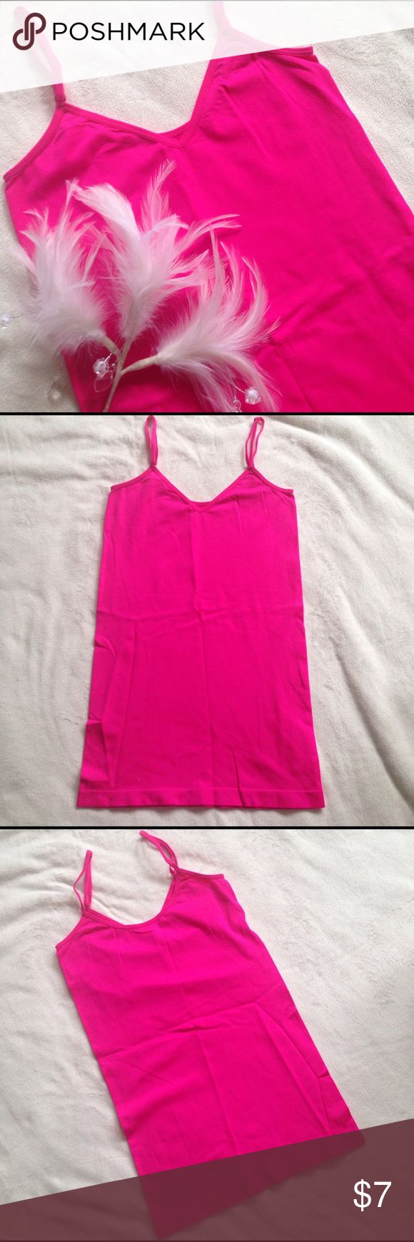 Hot pink seamless cami Vibrant hot pink seamless cami with adjustable straps. Perfect for v-necks or scoop necks as cami can be switched back and forth for either neckline🌺 The best shade of hot pink for a splash of neon color.💕Size and materials tag is removed but is s/m and feels like nylon blend. Tops Camisoles