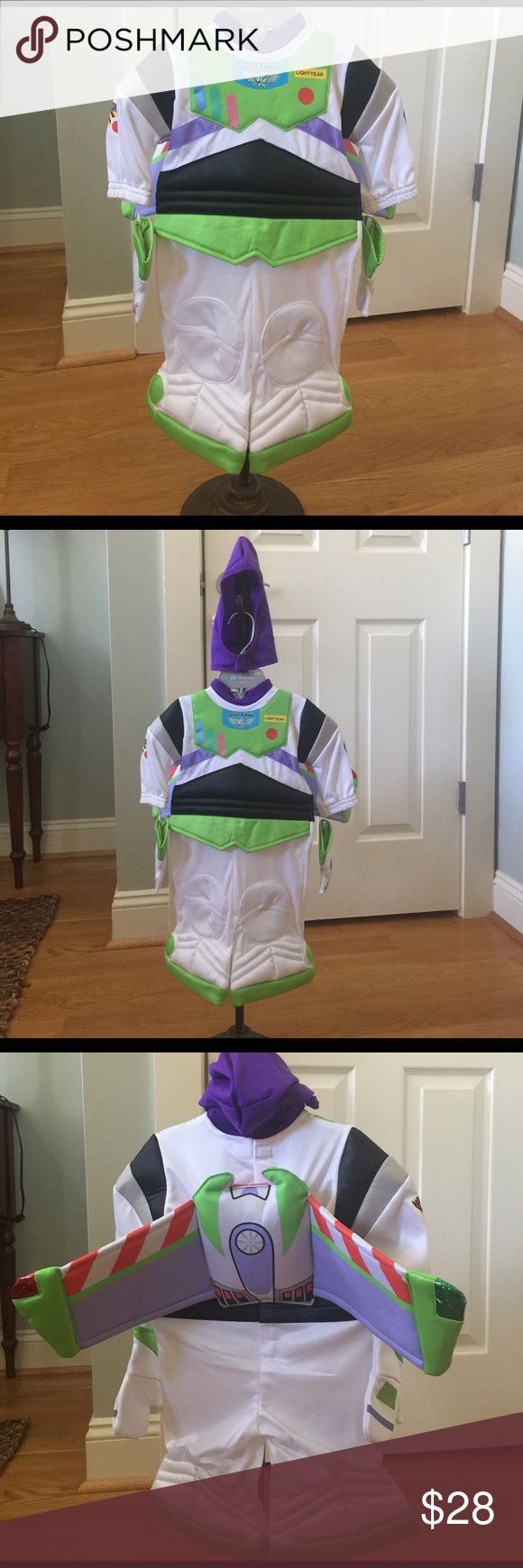 Disney's baby 🚀Buzz Lightyear🚀 Space Ranger Disney's baby 🚀Buzz Lightyear🚀 Space Ranger 3-6 months old!!  This costume is the cutest. It has detachable wings, by Velcro gloves, and a purple hood!!  NWT and is perfect for the new baby boy this summer to use in October!! Disney baby by Disney Store Costumes Halloween