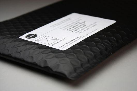 Label on black padded envelope - simple & effective