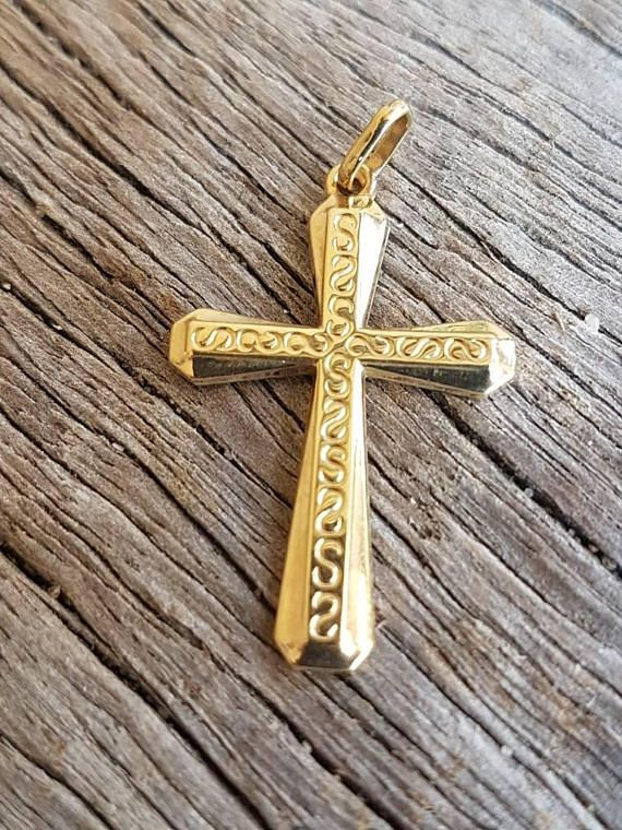 Check out this item in my Etsy shop https://www.etsy.com/au/listing/572328733/vintage-gold-cross-pendant-9ct-real
