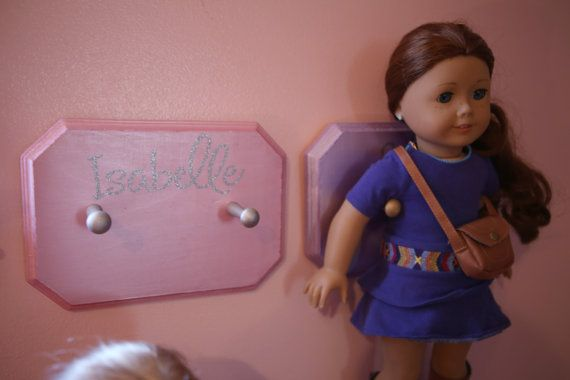 "18"" Doll holder for wall - Doll holder holds 18 American girl dolls. Plaque is hand painted in pearl paint to give it a shiny look, by AMvinyl on Etsy  $12.00"