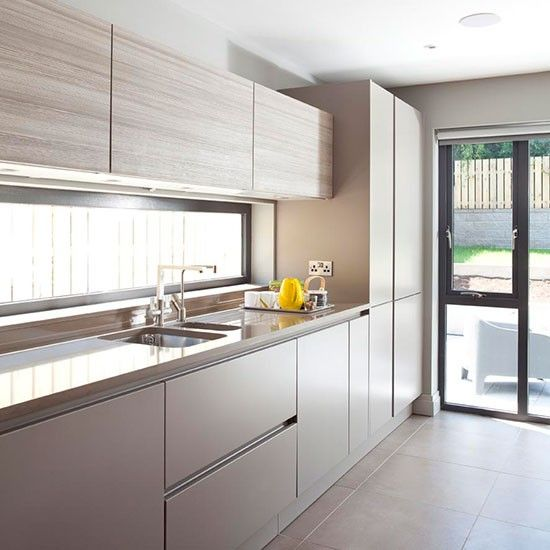 Sleek handleless kitchen cupboards in a neutral lacquer and Larch wood finish look wonderful with a neutral porcelain tile floor, which is hard-wearing and looks fantastic. http://www.housetohome.co.uk/kitchen/picture/grey-and-porcelain-floor-tiled-kitchen#WjIf0IJMQwK18SZy.32