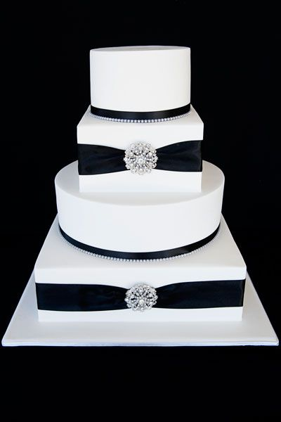 Wedding Cake love the combo of square and circle cake. Would replace the ribbon with red ribbon and topping with edible red roses made from fondant