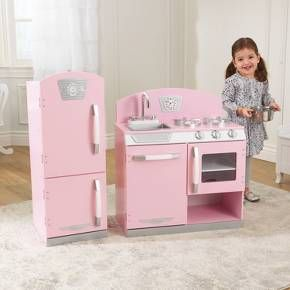With our KidKraft Pink Retro Kitchen, kids can cook up a feast for the whole family. The young chefs in your life are sure to love this wooden kitchen's sweet colors and adorable details. Two-piece modular construction allows for unique kitchen layouts to suit any size play area. And with its durable wood construction, this kitchen will provide years of imaginative play.