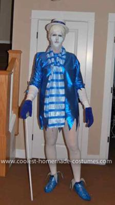 Homemade Snow Miser and Heat Miser Costumes: All homemade and a hit at the parties!  The best parts are the ice hair' made from candle wax over a paper mache mold.  The icicles on the nose are from
