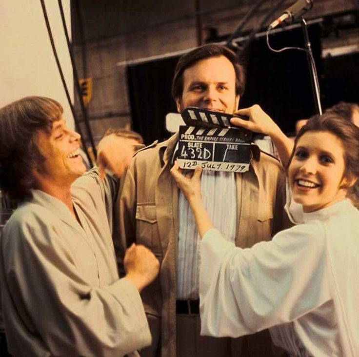 Mark Hamill, producer Gary Kurtz and Carrie Fisher on the set of The Empire Strikes Back (1980).