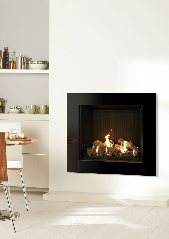 The eye-catching Riva2 750HL Icon XS gas fire adds a touch of grandeur with its reflective black glass and geometric design. Designed to fit into standard