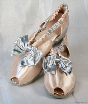 pink 1940s Hostess Slippers by Daniel Green.  I see these with wide leg satin pajama pants and a long cigarette holder.