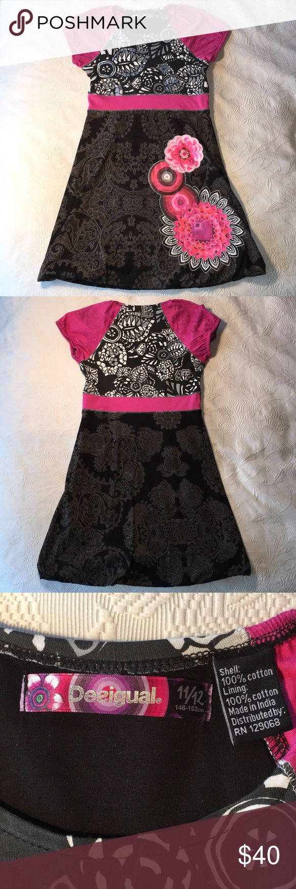 Desigual Girls' Dress. NWOT. 11/12 Fab, cute & comfy dress by Desigual for girls. 100% cotton with flower detail on skirt and very slight bubble detail at hem. Looks dressy enough for a party, feels good enough to play in - it's destined to be your daughter's new favorite dress! Desigual Dresses