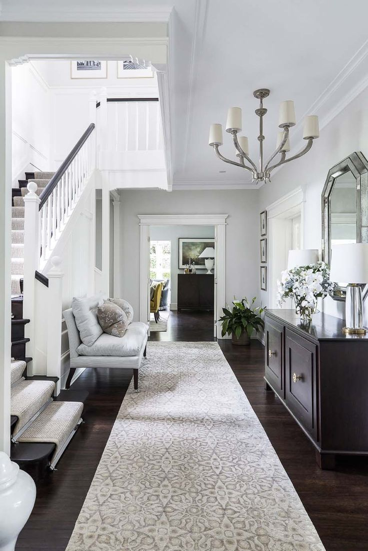 Open Entryway With Dark Accents And A Long Hallway Making The Space Feel Spacious And Airy Interior Design Coco Re Home House Interior Home Interior Design #open #entryway #living #room