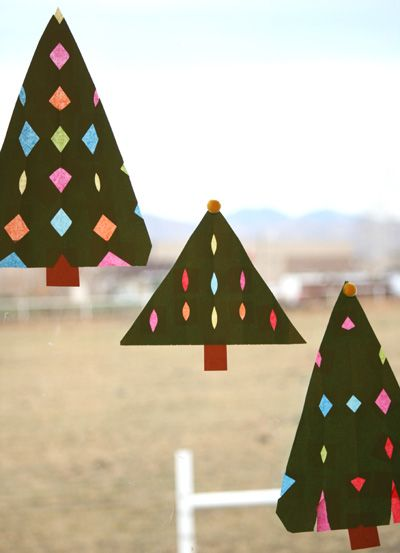 These Stained Glass Trees add a beautiful glow to the kitchen windows, giving the appearance of twinkly lights on a Christmas Tree. With each triangle tree cut up like a snow flake, it leaves just the right holes for colored tissue paper to shine in.