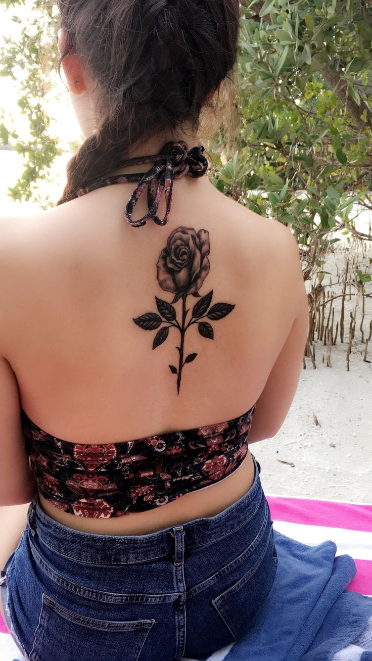 Black rose back tattoo