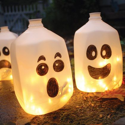 Simple, easy and cute! I made 10 of these plus some 1/2 gallon jugs (on their sides) with arrows pointing to our neighbor's house, where we have our annual Halloween Garage Party.  These ghosts will be lined up across our drive-way so trick-or-treaters will know we're not home,  but next door!  Original posting: Halloween Craft: Spirit Jugs | Halloween Yard Crafts