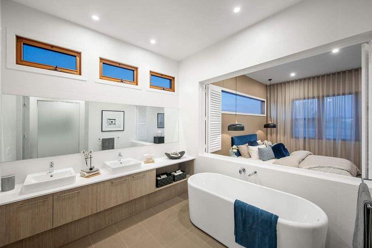 A spectacular master ensuite overlooks the beautiful bedroom #weeksbuildinggroup #newhome #homedesign