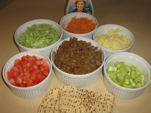 Pita Bread Sandwiches from Food.com: When my girls were young, they could not eat a taco without breaking the shell and having a mess! I started making them pita bread sandwiches and they loved them. Adults like them also. Very easy and a quick meal on weekdays when time is short.