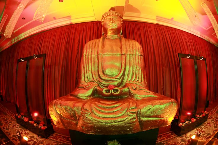 Enhanced Lighting installed Red Silk Drapery to create a special dance room for this Ritz Carlton SF Wedding.  The 12' Buddah and 2 water features were also lit by Enhanced.