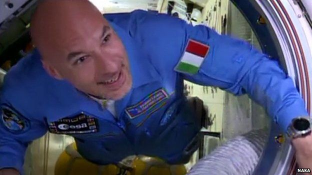 Luca Parmitano floats through the hatch into the International Space Station