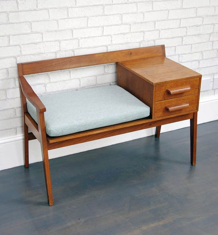 Made by British company ' Chippy Heath' in the 1960s, this telephone table is a great example of mid-century design. Description from bringitonhome.co.uk. I searched for this on bing.com/images