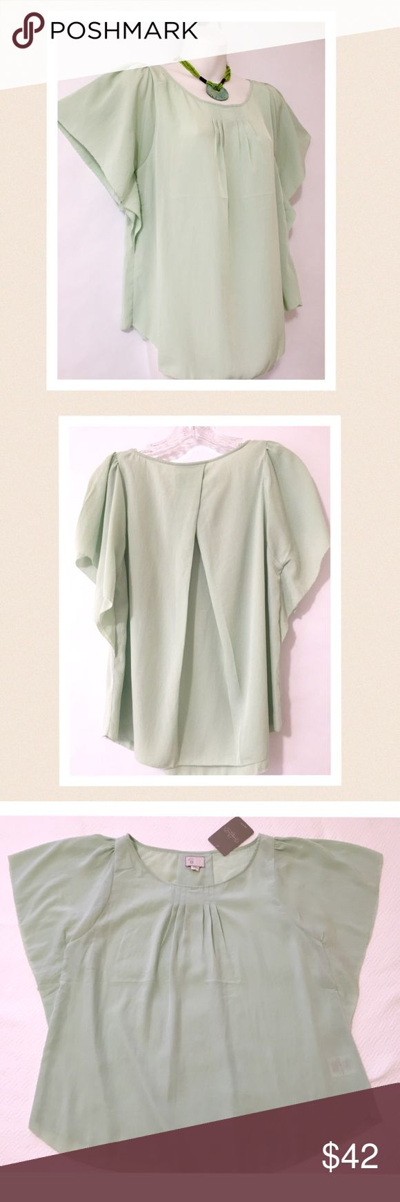 """Anthropologie mint green top. New with tags Soft and ultra-feminine mint green top. Gentle pleats at the scoop neck and large pleat at the back create a flowy feel and design. Raw edge hem and raw edge on batwing sleeves. Perfect condition. 🔹bust 19"""" across the front armpit to armpit🔹length 23"""" The tag says size 00 but the cut, design and measurements indicate that this top could fit sizes xtra small through medium. Anthropologie Tops"""