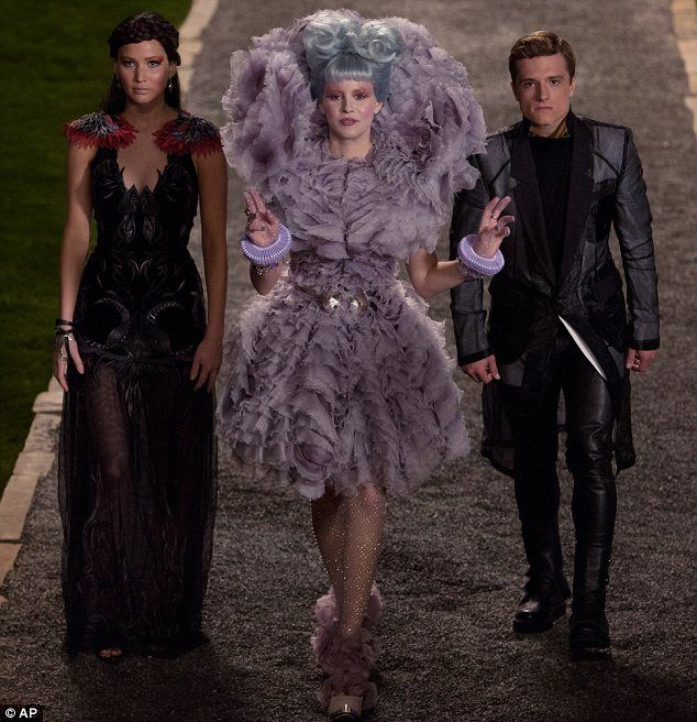 Now YOU can dress like Katniss: Hunger Games-inspired clothing line created by movie's costume designer to launch this fall