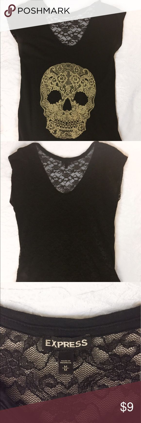 Express Graphic Tee Woman's Black Lace Skull Top This is a graphic tee from express. The entire back is see-through lace. The front has a beige lace skull with some small studs attached. Loose fit. Express Tops Tees - Short Sleeve