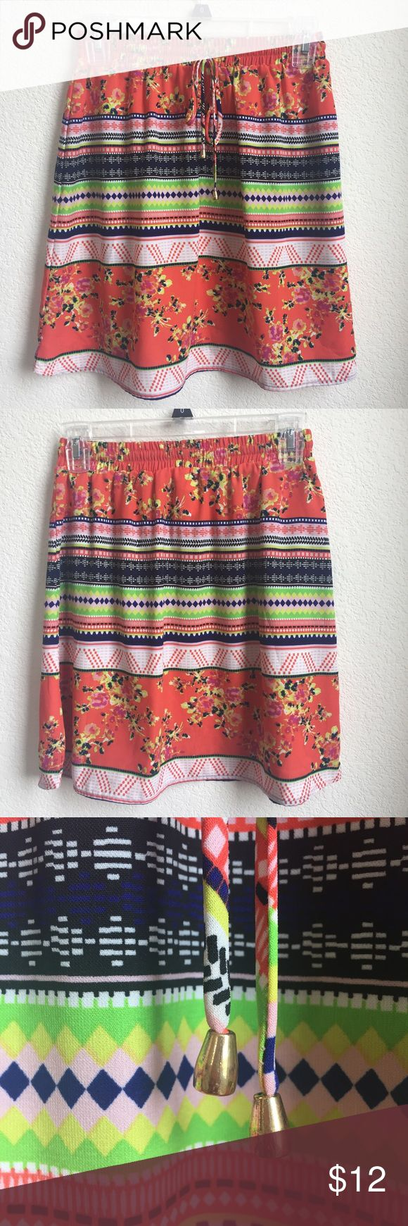 Xhiliration Bright and Colorful Tribal Print Skirt Fantastic, fun, flirty summer item. Would go perfect with strappy sandals. Drawstring waste with gold ends. Has a little wear on the gold ends of the drawstring, pictured. Worn only a few times. From Target. Xhilaration Skirts