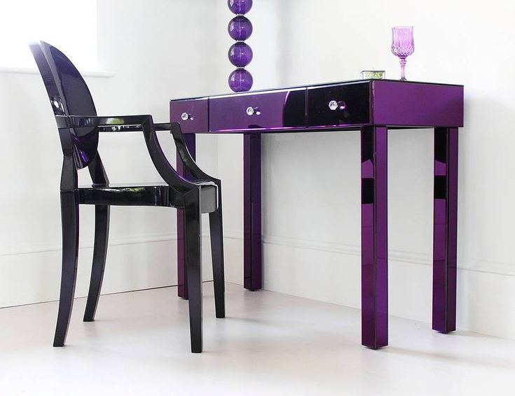 This superb purple glass dressing table is one of our favourite products. Finished in mouthwatering, deep purple glass, this is a piece of furniture that will never fail to be noticed. Part of a small range of exciting purple bedroom furniture, this glass dressing table features three drawers, each with a round cut glass handle. Drawers are on smooth sliding runners and all edges are bevelled for a quality finish. A piece to treasure forever. ALL SCOTLAND CUSTOMERS: Additional shipping fees…