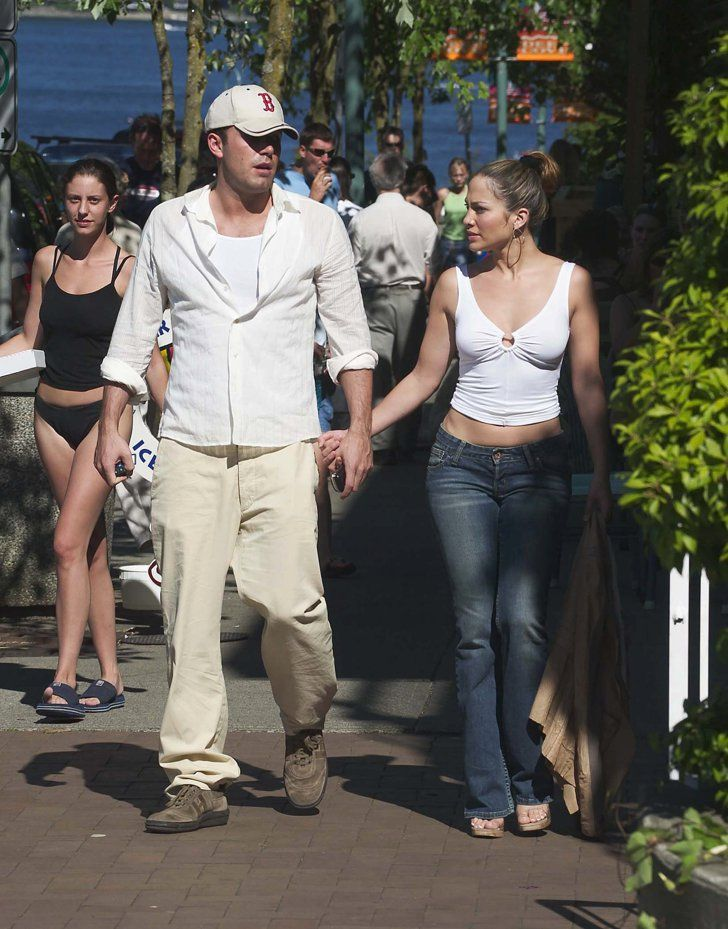 Pin for Later: These Photos of Jennifer Lopez and Ben Affleck Will Take You Way Back  The two looked casual and relaxed as they showed PDA in Vancouver in July 2003.