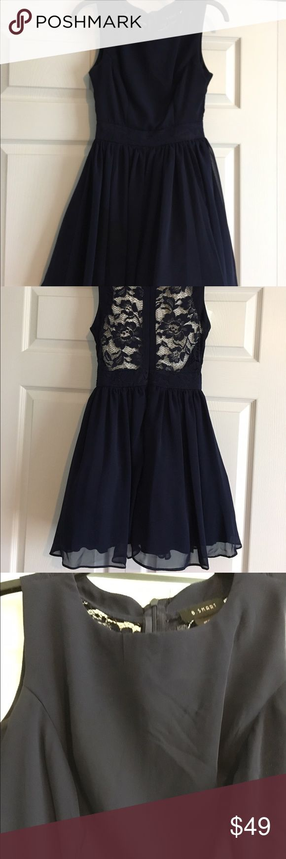 B. Smart short sleeveless dress size 3 navy blue B. Smart dress navy blue sleeveless - worn once - lace back shown with white underneath to show how it would look.  Short hemline which does flare with underlying of mesh.  Front is solid - not shear like back. Size 3 B. Smart Dresses Mini