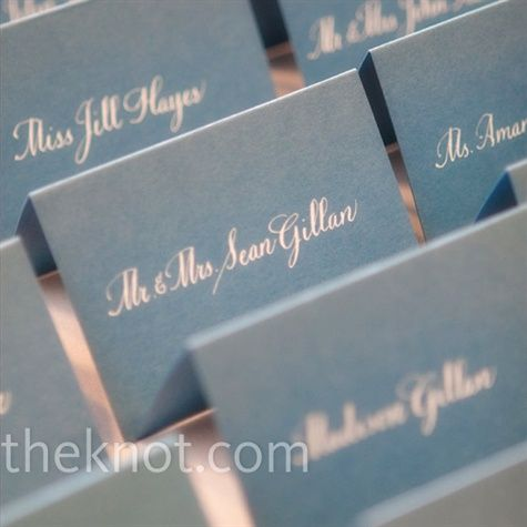 Guests' names written in white calligraphy popped against blue cardstock.