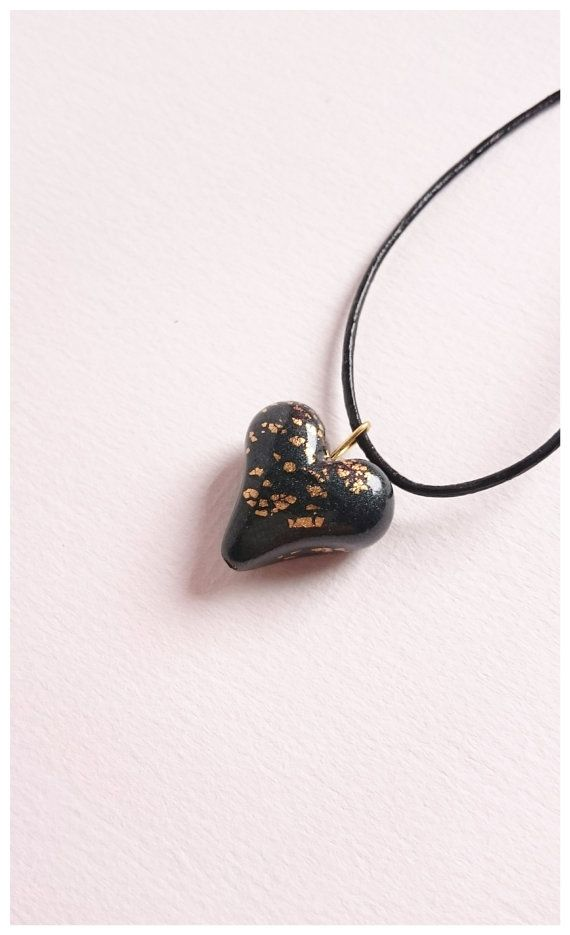 Polymer clay jewelry, black heart pendant with gold flakes