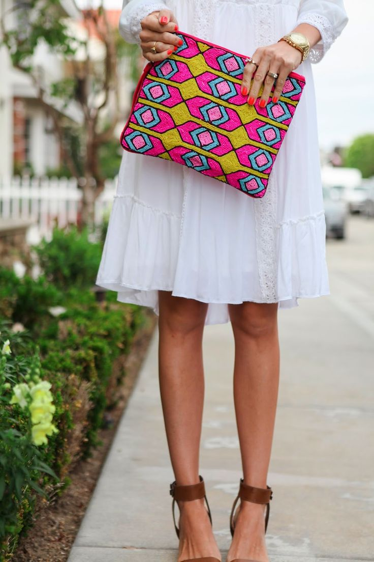 Moroccan beaded clutch with a white boho dress. A perfect summer outfit.