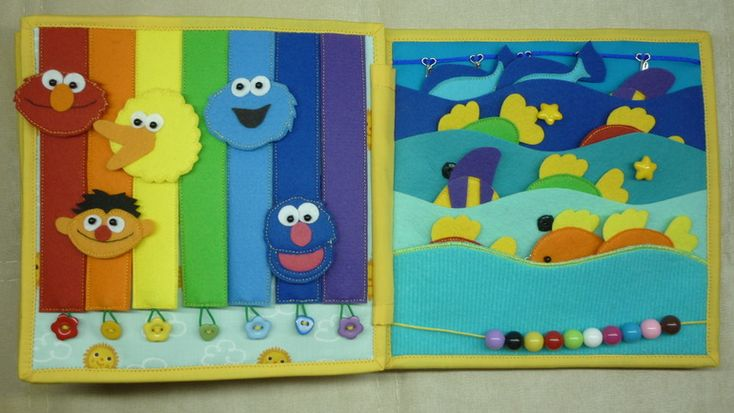 Развивающая книжка для Тимы! <-- I have no idea what that says, but the rainbow-button page looks cute!