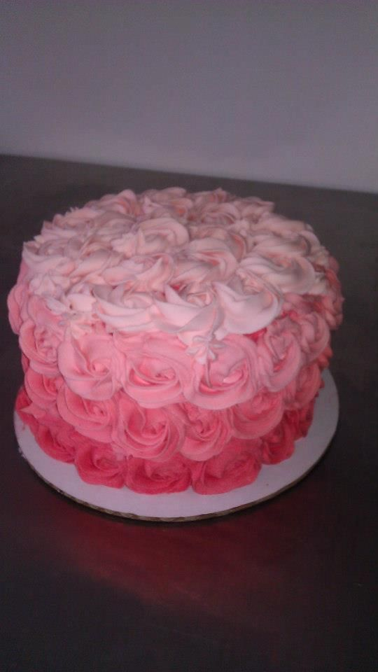 Ombre rosette cake in hot pink to light pink for a woman's birthday