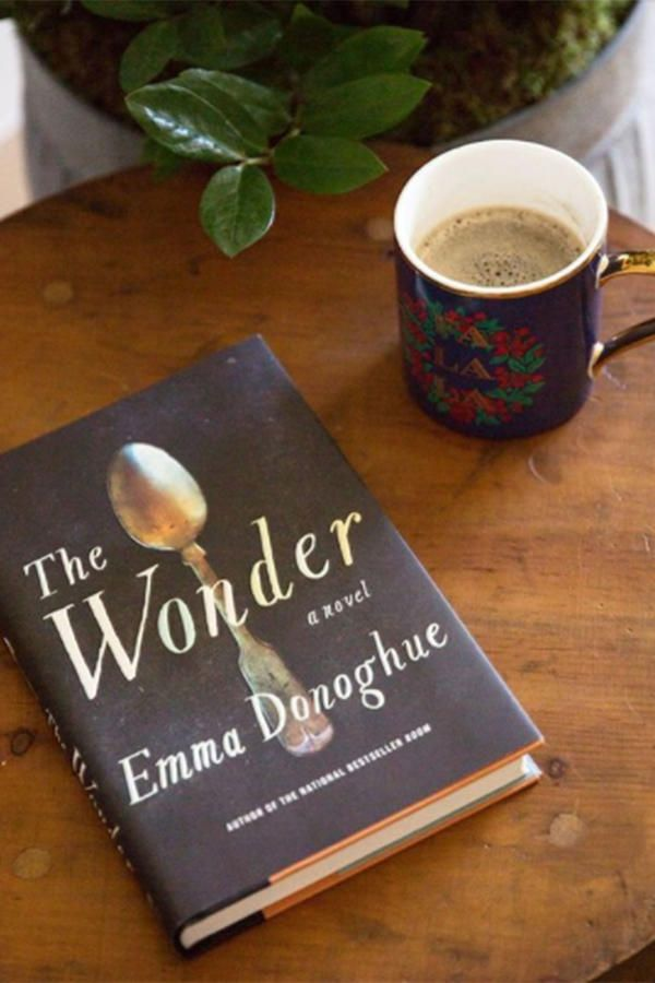 """The Wonder by Emma Donoghue - 16 Books on Reese Witherspoon's Must-Read List - Southernliving. Lib, an English nurse, travels to an Irish village to observe a young girl who claims to have survived on no food for four months. Is it a hoax or a miracle? That's the question Lib asks herself, when the child's health suddenly begins to decline. Witherspoon called this book one of her """"rainy day essentials.""""  Buy It! The Wonder, $27; amazon.com"""
