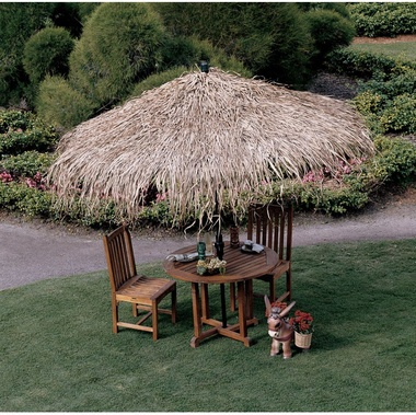 OMG such a great idea!  This is a tropical thatch umbrella cover.  Next best thing to a tiki bar...and a great way to continue to use a patio umbrella that you thought you needed to replace because it faded.