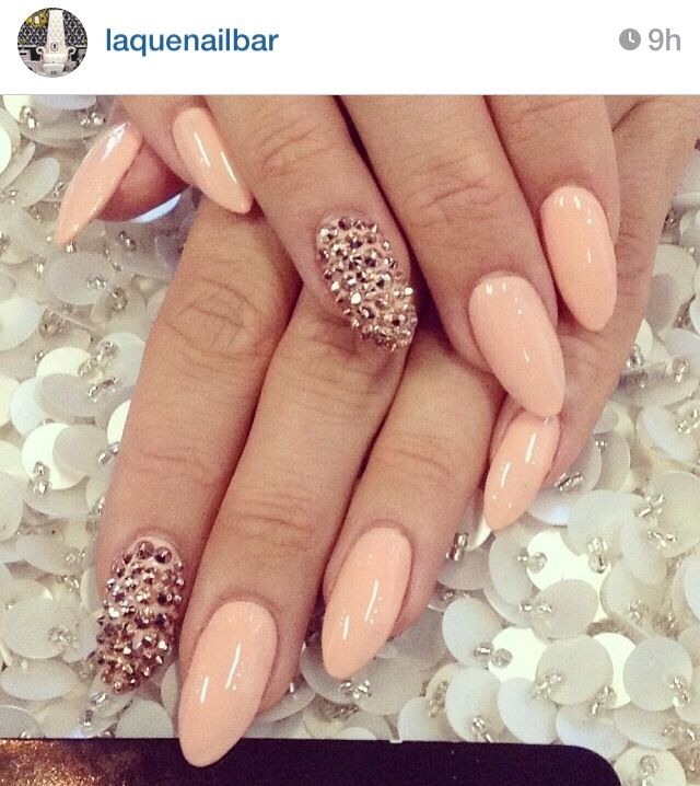 Peach nail art with adorned crystal stand out nail...x