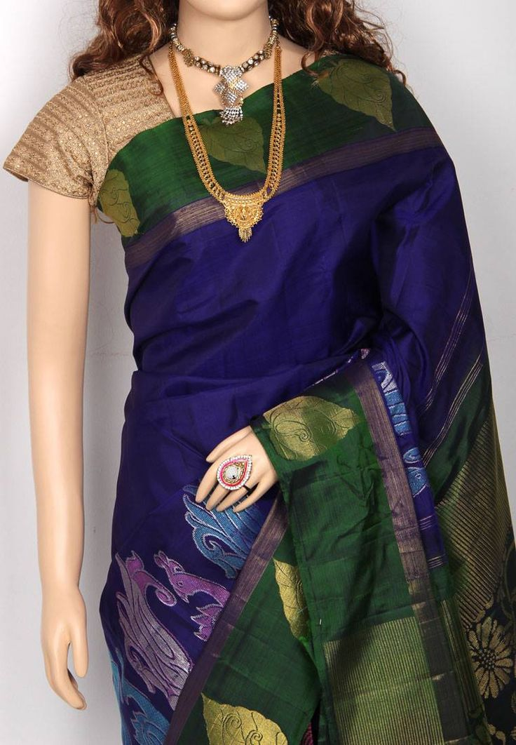 Ink Blue Colored Partly Designed Silver jari motif Bottle Green Color Bordered Pure Silk Saree with Bottle Green Colored Blouse Part @ Rs.12500 http://www.shreedevitextile.com/women/sarees/silk-saree/shree-devi/ink-blue-colored-pure-silk-saree-1003